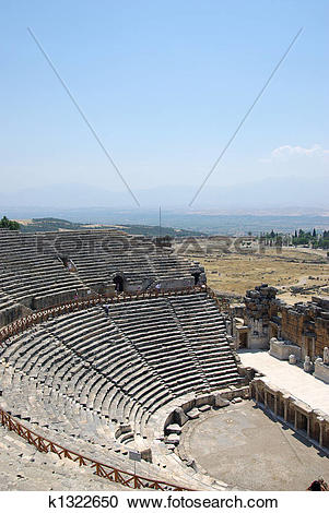 Stock Photography of Amphitheater ruins in ancient city Hierapolis.
