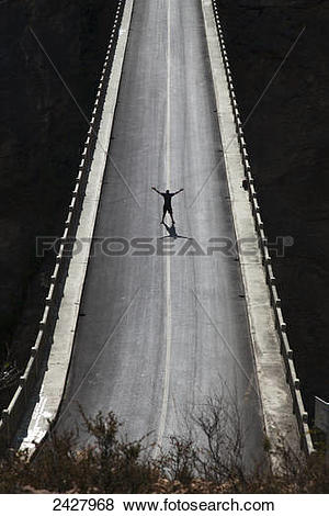 Pictures of Silhouette of man on high bridge; Lijiang, Yunnan.