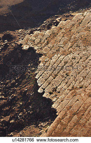Stock Images of Aerial of deteriorating rock cliff in high desert.