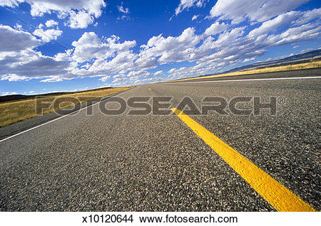Stock Photo of USA, Wyoming, Dubois, roadway across high desert.