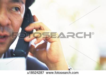 Picture of Businessman making phone call, High Key u18524287.