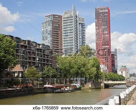 Stock Photograph of High rise office blocks and Red Apple.
