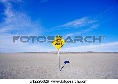 Stock Photograph of High water sign in dry lake bed x12295629.