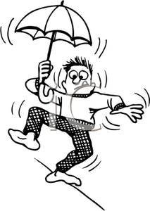Walking on a High Wire Holding an Umbrella.