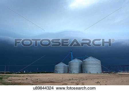 Stock Photo of Arcus cloud from storm over grain silos, Dalhart.