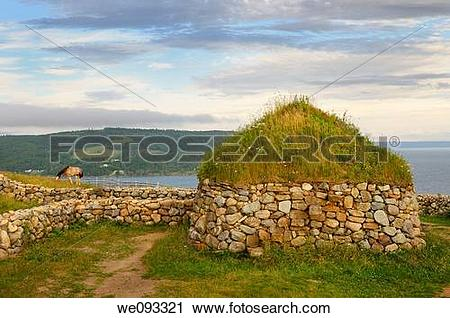 Stock Photography of Clydesdale horse and Black House with sod.