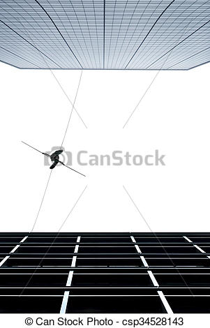 Stock Photo of Highline walker concept of risk taking and.