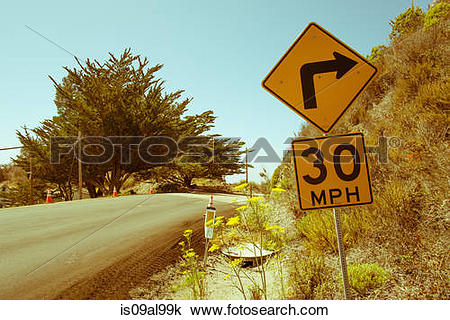 Stock Photo of Yellow speed warning sign, highway 1, Big Sur.