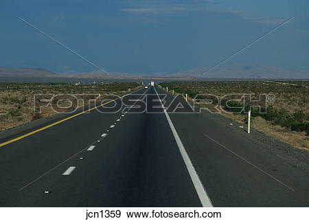 Stock Photograph of Perspective view on the Highway 93 in desert.