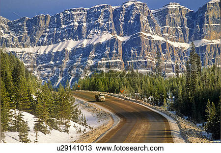 Stock Photo of Truck driving on Trans Canada Highway with Castle.