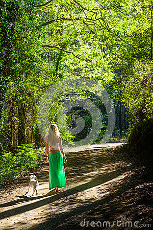 A Girl And Her Dog Walking Along A Hiking Trail In The Troodos.