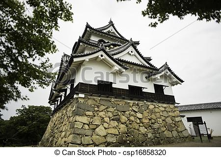 Stock Photo of Hikone castle framed by leaves.
