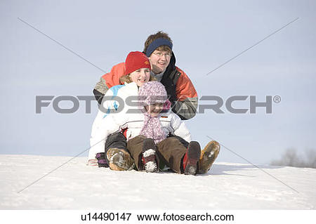 Picture of 15, 13 and 9 year olds prepare to slide down hill.