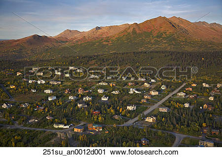 Stock Photography of Aerial over residential neighborhoods along.