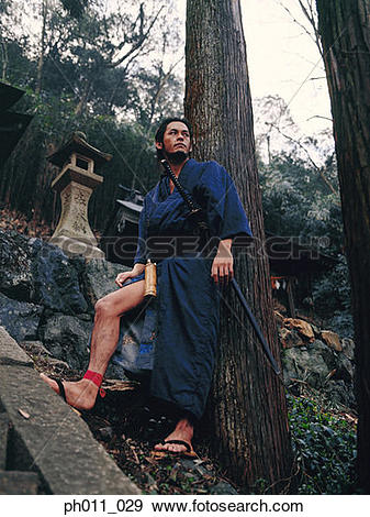 Stock Photograph of Samurai warrior standing on a hill slope.