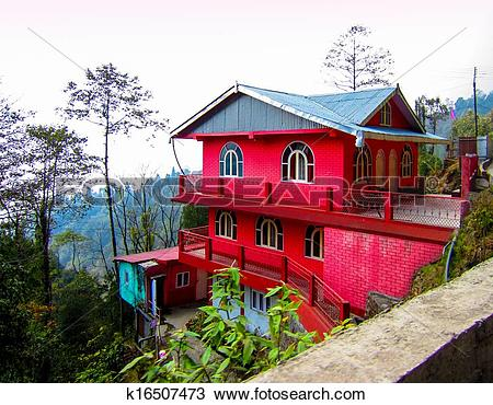 Stock Photo of Red house on a hill slope k16507473.