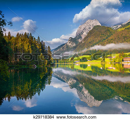 Stock Photo of Misty summer morning on the Hintersee lake in.