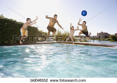 Stock Photo of Hispanic father and children jumping into swimming.