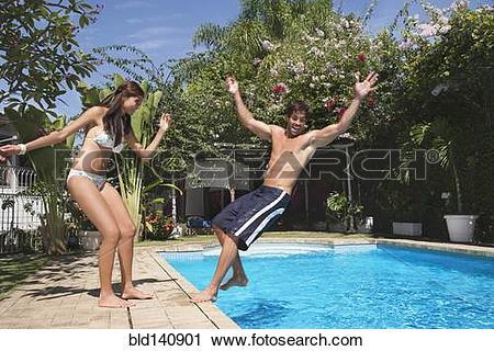 Stock Photography of Hispanic woman pushing boyfriend into.