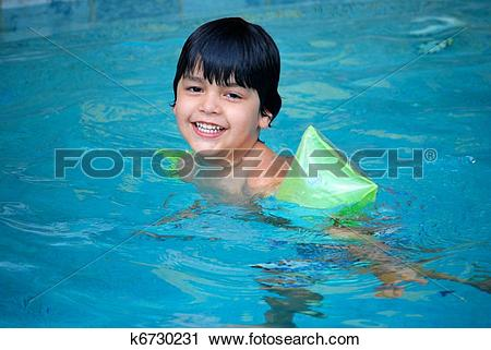Stock Photography of Hispanic boy swimming in the pool k6730231.