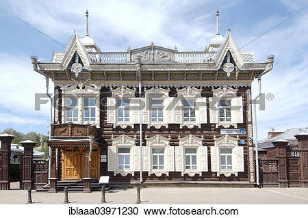 """Stock Photography of """"Wooden log house, historic city center."""