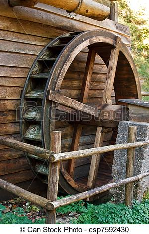 Stock Photography of Historic water mill wheel.