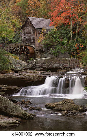 Stock Photo of A historic grist mill building on the banks of.