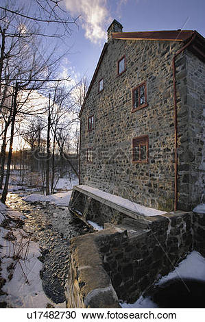 Stock Photography of View of historic mill at sunset, Parc du Mont.