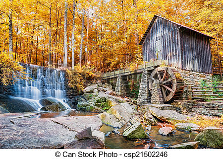 Stock Photo of Fall or Autumn image of historic mill and waterfall.