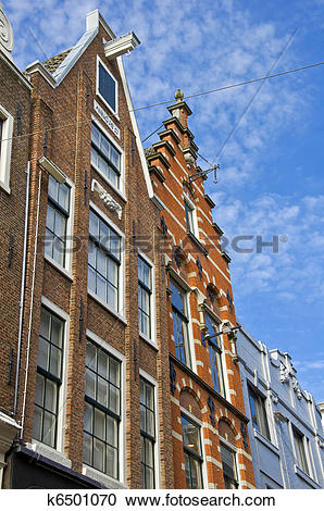 Stock Photography of Amsterdam. Dutch houses with a hook at the.