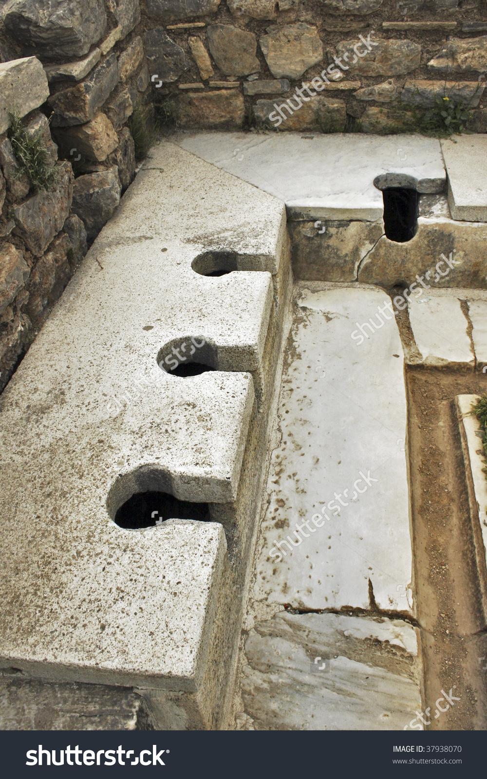 Roman Public Toilet. Turkey, Ephesus. Sumer Time. Stock Photo.