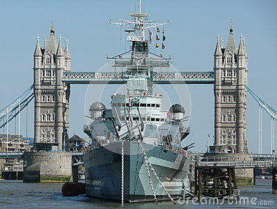 HMS Belfast Moored By Tower Bridge London Stock Photo.