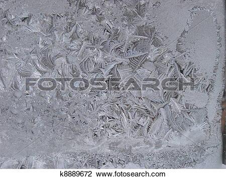 Clip Art of Hoarfrost on window glass in frosty weather k8889672.