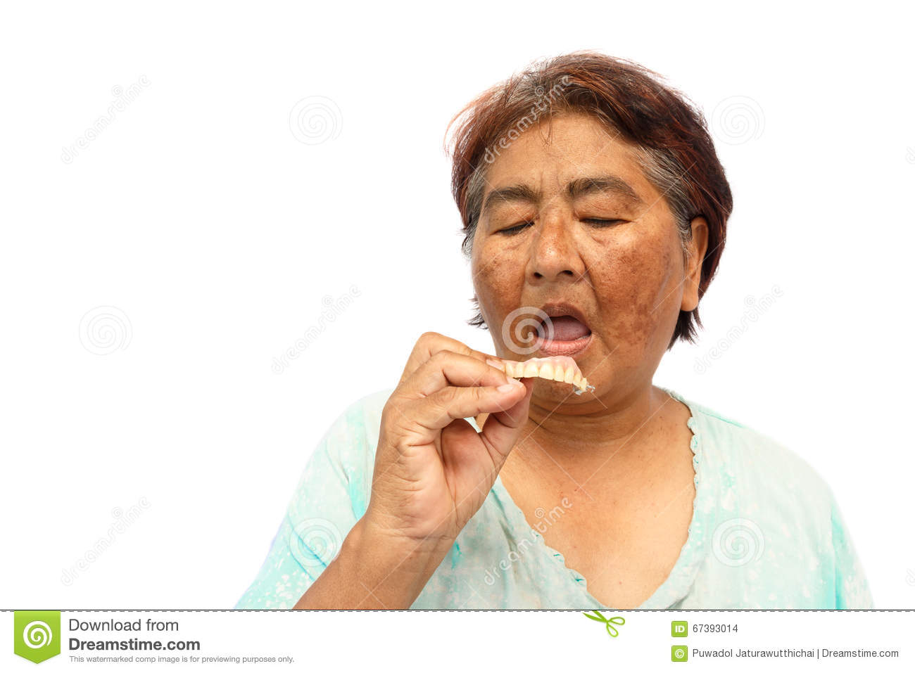 Putting dentures in mouth clipart.