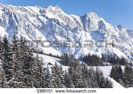 Stock Photography of View of an alpine cabin in front of the.