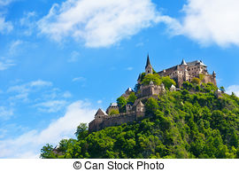 Stock Photos of Hochosterwitz castle in Austria behind the forest.
