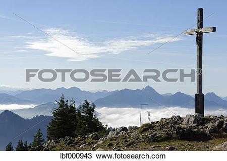 Stock Photo of Germany, Bavaria, Chiemgau, Summit cross of the.