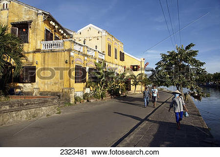 Stock Photography of People Walking Along Waterfront Of Historic.