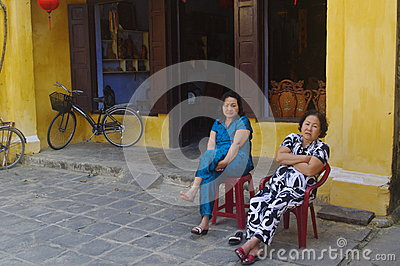 Vietnamese Women Having Relaxing Rest In Colonial Town Of Hoi An.