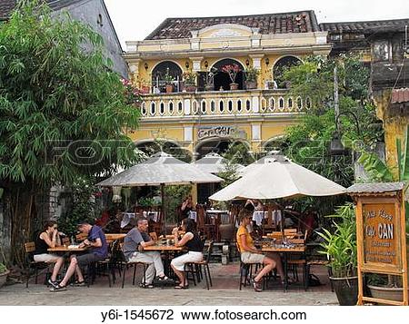 Stock Photo of Outdoor dining is a popular in Hoi An colonial.