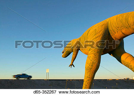 Picture of ?Hungy? dinosaur statue and vehicle on I.
