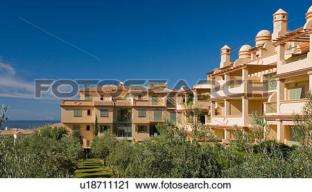Stock Photography of Neutral modern apartment building in holiday.