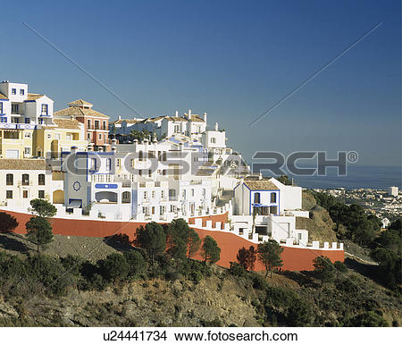 Stock Photo of Villas and apartment buildings in white holiday.