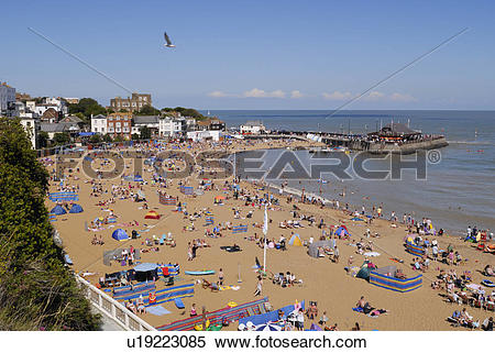 Stock Image of England, Kent, Broadstairs, Holiday makers on the.