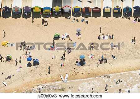 Stock Photo of Aerial view of holiday makers and beach huts on.