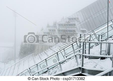 Pictures of Holmenkollen ski jump in fogg, Oslo, Norway.