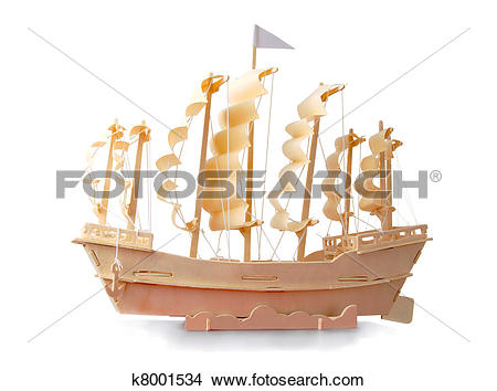 Stock Photo of Homemade wooden ship with paper sails and a flag on.