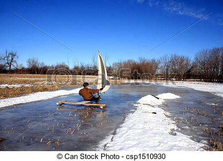 Stock Photography of A retired senior is steering his ice boat.