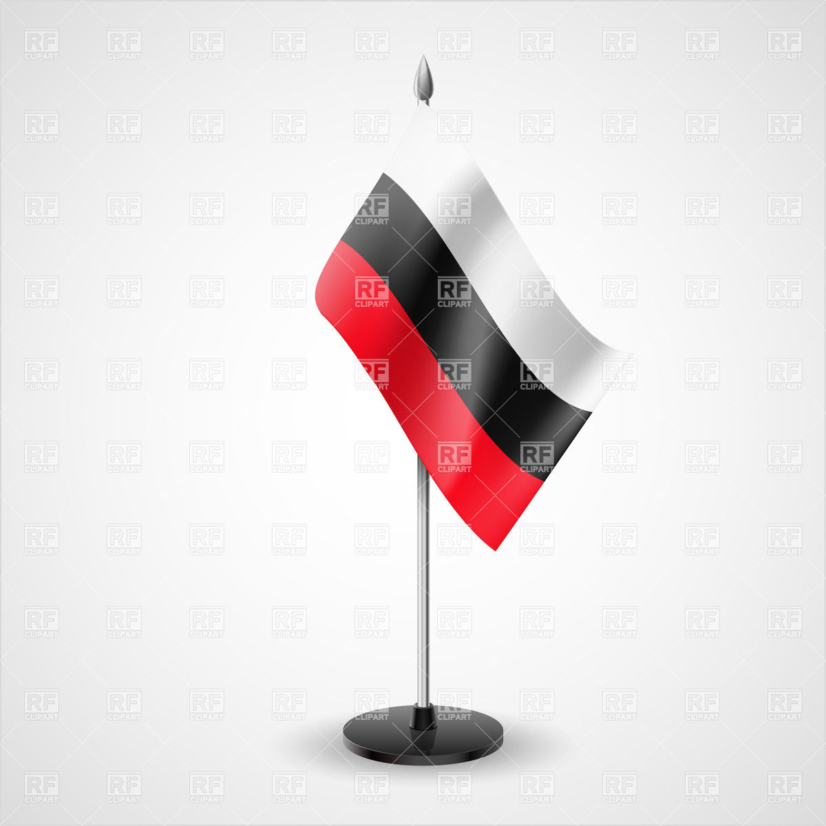 Tricolor table flag of white, black and red horizontal stripes.