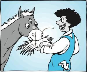 Boy Feeding a Horse Some Hay.